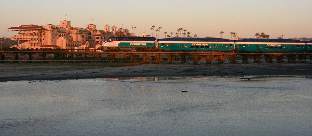 Amtrak surfliner and coaster trains at del mar california the bridge is immediately west of the del mar racetrackfairgrounds made famous by bing crosby jimmy durante and others of that holywood era publicscrutiny Images