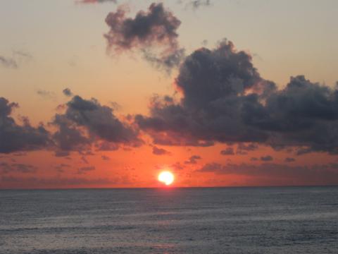 The Setting Sun In The Tropical Caribbean Sea