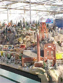 A Closeup Of The Fire Tower And Power Plant On The Garden Factory Train Display